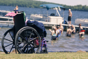 Wheelchair on beach at Pine Tree Camp