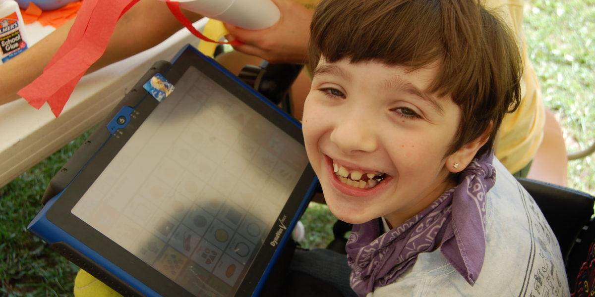 child uses assistive technology to communicate