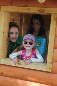 Pine Tree Camper Abby in the playhouse