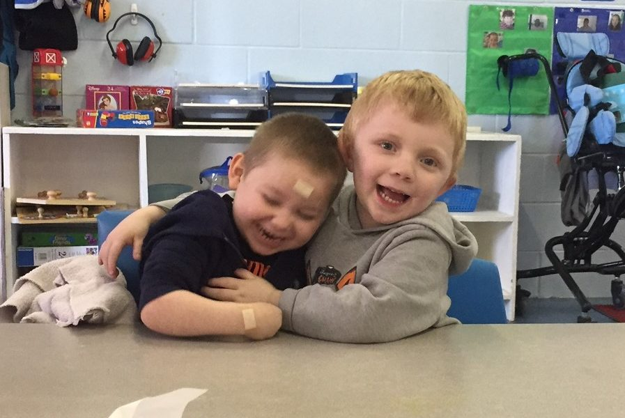 Boys giving a hug at the Early Learning Center